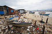 Fishing Harbour at the mouth of Cai River. Fishermens' huts, partially destroyed by a recent typhoon.