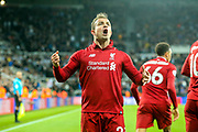 Xherdan Shaqiri (#23) of Liverpool celebrates Liverpool's third goal (2-3) scored by Divock Origi (#27) of Liverpool during the Premier League match between Newcastle United and Liverpool at St. James's Park, Newcastle, England on 4 May 2019.