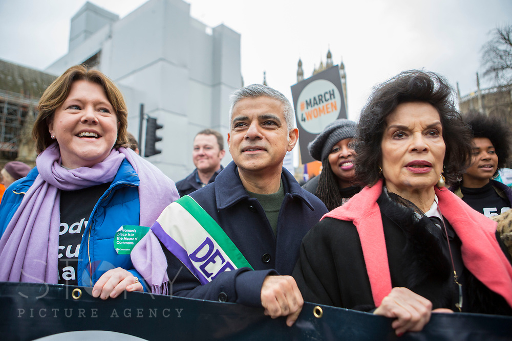 UNITED KINGDOM, London: 04 March 2018 London Mayor Sadiq Khan (centre) and Bianca Jagger (right) join thousands of supporters during the #March4Women rally in London this afternoon. Thousands of people marched from Parliament to Trafalgar Square to celebrate International Women's Day and 100 years since the first women in the UK gained the right to vote. <br /> Rick Findler / Story Picture Agency