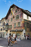 Haus zum Ritter, built in 1492, is a Swiss heritage site of national significance, featuring one of the most important Renaissance frescoes north of the Alps. Address: Vordergasse 65, Schaffhausen, Switzerland, Europe. The original frescoes by Tobias Stimmer were taken off the facade in 1935, preserved and displayed in the Museum zu Allerheiligen. The mural depicts and praises the civil virtues.
