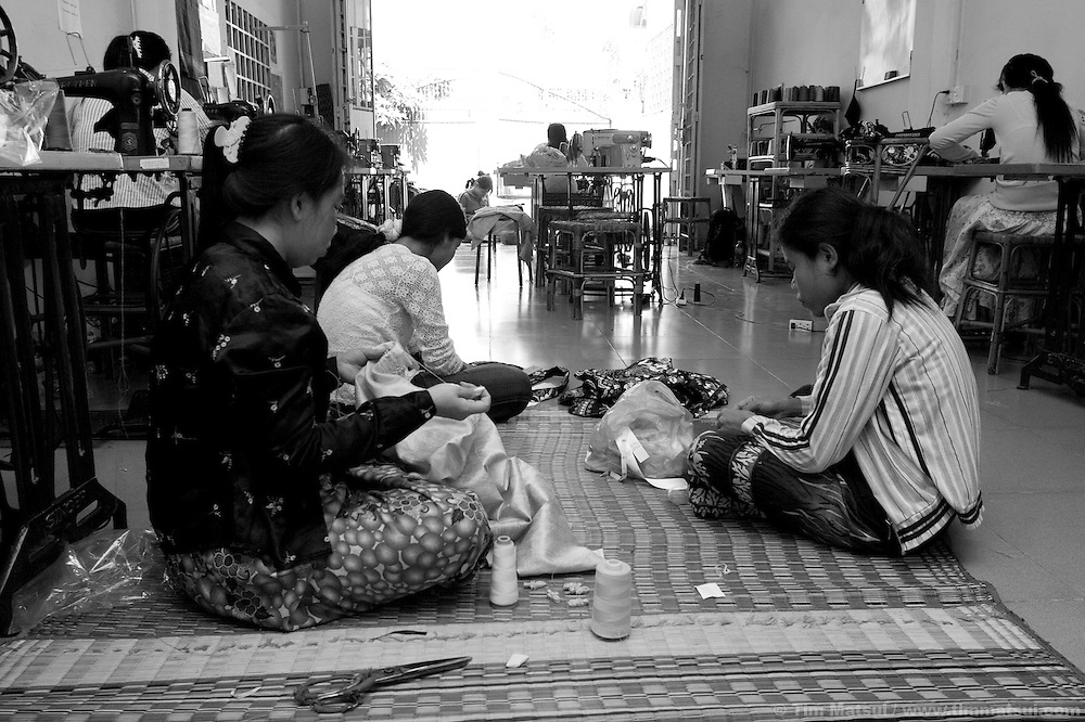 "Women at the AFESIP Fair Fashion workshop where they are paid a fair wage to produce garments and accessories under international fair trade guidelines in Phnom Penh, Cambodia. ""Acting for Women in Distressing Situations"" (AFESIP) conducts is an ""A to Z"" Cambodian relief agency providing outreach, health services, retraining, residential housing, and through Fair Fashion it is providing jobs. AFESIP clients are victims of sex trafficking, ex-prostitutes, or domestically abused. Founded by Somaly Mam, who herself was once a prostitute and victim of trafficking and domestic abuse, AFESIP has three facilities in Cambodia and works with other NGO's to provide long term care for the women."