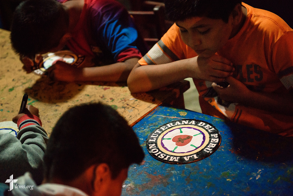 Children paint Luther Rose woodcuts during an activity at Castillo Fuerte in San Juan de Lurigancho on Tuesday Nov. 7 2017, in Peru.  LCMS Communications/Erik M. Lunsford