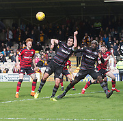 28th April 2018, Fir Park, Motherwell, Scotland; Scottish Premier League football, Motherwell versus Dundee; Carl McHugh of Motherwell heads cleat