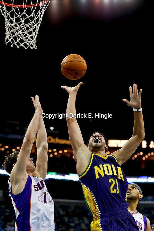 Feb 6, 2013; New Orleans, LA, USA; New Orleans Hornets point guard Greivis Vasquez (21) shoots over Phoenix Suns point guard Goran Dragic (1) during  the first quarter of a game at the New Orleans Arena. Mandatory Credit: Derick E. Hingle-USA TODAY Sports