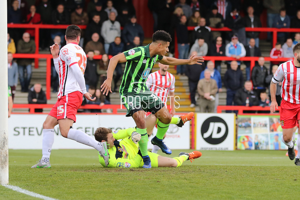 Lyle Taylor forward for AFC Wimbledon (33) and Jamie Jones (goalkeeper) of Stevenage FC (1)  during the Sky Bet League 2 match between Stevenage and AFC Wimbledon at the Lamex Stadium, Stevenage, England on 30 April 2016. Photo by Stuart Butcher.