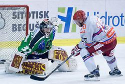 Mickel Bayrack (HK Acroni Jesenice, #15) vs Jan Chabera (HDD Tilia Olimpija, #32) during ice-hockey match between HDD Tilia Olimpija and HK Acroni Jesenice in 41st Round of EBEL league, on Januar 23, 2011 at Hala Tivoli, Ljubljana, Slovenia. (Photo By Matic Klansek Velej / Sportida.com)