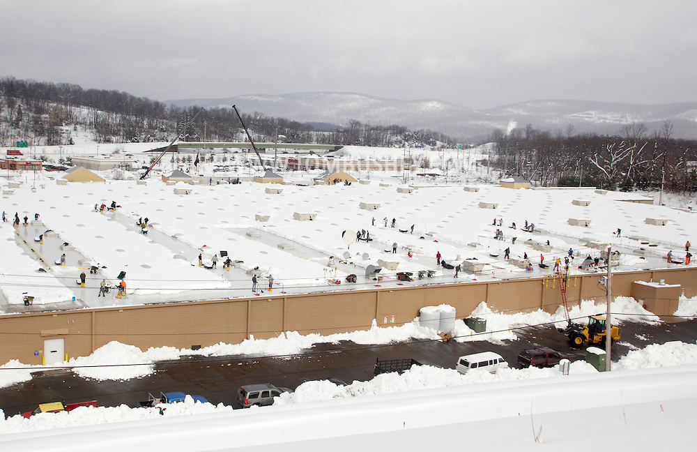 Harriman, New York - Workers use shovels and wheel barrows to remove snow from the roof of the Walmart store after a two-day storm dropped more than 30 inches of snow on Feb. 27, 2010. The store remained closed until the snow was removed and the roof was inspected.