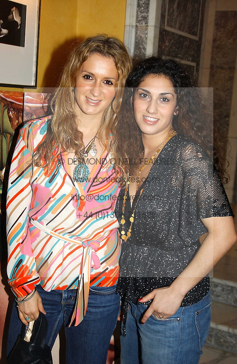 Left to right, fashion designers VANYA STROK and NARGESS GHARANI at the launch of MAC's High Tea collection with leading British designers held at The Berkeley Hotel, London on 17th January 2005.  MAC has collabroated with The Berkeley's Pret-a-Portea, which adds a creative twist to th classic elements of the English afternoon tea with cakes and pastries inspired by fashion designs.<br />
