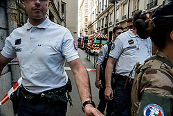 May 24, 2019 - Lyon, France - French police scour the area for evidences in front the 'Brioche doree' after a suspected package bomb blast along a pedestrian street in the heart of Lyon, southeast France on May 24, 2019. More than a dozen people were injured in the explosion. (Credit Image: © Nicolas Liponne/NurPhoto via ZUMA Press)