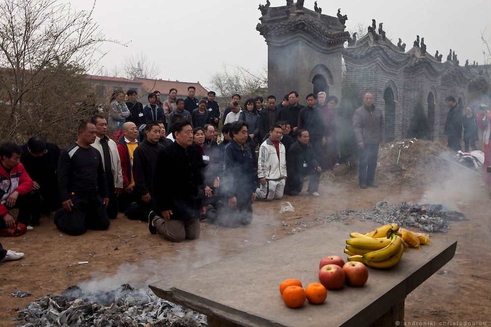 Grandmasters Chen Xiaowang and Chen Xiaoxing (center left and right) during a visit to their family's ancestral graves where together with other members of their family they pay their respects to their ancestors with a ceremony.