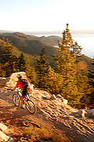 Doug Nurock mountain biking along the Flume Trail. Lake Tahoe, CA