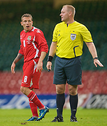 CARDIFF, WALES - Saturday, October 11, 2008: Wales' captain Craig Bellamy argues with referee Thomas Vejlgaard during the 2010 FIFA World Cup South Africa Qualifying Group 4 match against Liechtenstein at the Millennium Stadium. (Photo by David Rawcliffe/Propaganda)