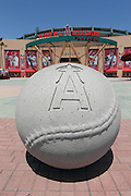 ANAHEIM, CA - MAY 15:  A concrete baseball with the logo of the Los Angeles Angels of Anaheim on it frames the foreground in this general view photo of the main entrance to Angel Stadium before the game against the Oakland Athletics on Tuesday, May 15, 2012 in Anaheim, California. The Angels won the game 4-0. (Photo by Paul Spinelli/MLB Photos via Getty Images)