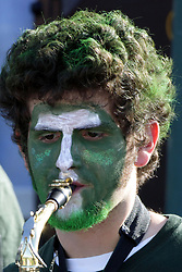 04 October 2008: Band member with a painted face in a battle between the Carthage Red Men and the Illinois Wesleyan University Titans, .Game action was at Wilder Field on the campus of Illinois Wesleyan University in Bloomington Illinois.