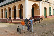 TRINIDAD, CUBA - OCTOBER 30, 2006: Unidentified people walk in front of the Brunet palace in Trinidad, Cuba. Town of Trinidad in Cuba is declared a UNESCO World Heritage site.