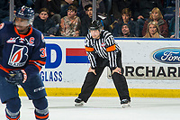 KELOWNA, CANADA - FEBRUARY 23:  Referee Chris Crich stands on the ice at the Kelowna Rockets against the Kamloops Blazers on February 23, 2019 at Prospera Place in Kelowna, British Columbia, Canada.  (Photo by Marissa Baecker/Shoot the Breeze)