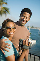 Couple with Video Camera at Marina