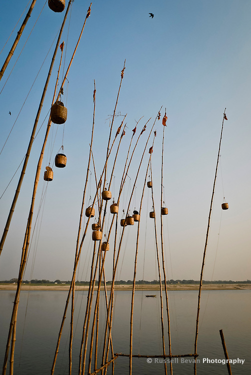 Lanterns on poles on the banks of the River Ganges in Varanasi, Uttar Pradesh, India