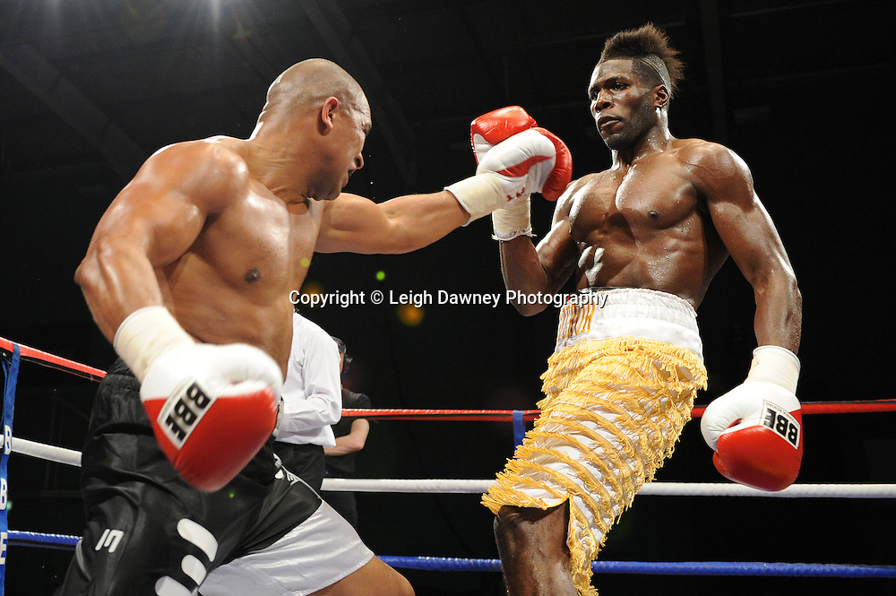 Menay Edwards (yellow stripe shorts) defeats John Anthony at Medway Park, Gillingham, Kent, UK on 13th May 2011. Frank Maloney Promotions. Photo credit © Leigh Dawney 2011.