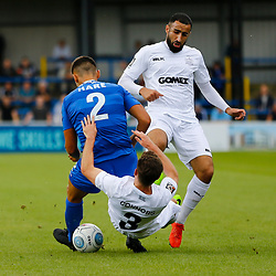 Eastleighs defender Josh Hare sends Dovers defender Jack Connors crashing to the ground Dovers midfielder Aryan Tajbakhsh can only look on during the National League match between Dover Athletic FC and Eastleigh FC at Crabble Stadium, Kent on 25 August 2018. Photo by Matt Bristow.