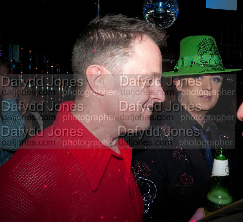 GRAHAM SMITH; BOY GEORGE, Launch of  Photography bookÔWe Can Be Heroes: London Clubland 1976 Ð 84Õ by Graham Smith.  Moonlighting (formerly Le Beat Route), 17 Greek St, Soho, London, 8 December 2011<br /> GRAHAM SMITH; BOY GEORGE, Launch of  Photography book'We Can Be Heroes: London Clubland 1976 – 84' by Graham Smith.  Moonlighting (formerly Le Beat Route), 17 Greek St, Soho, London, 8 December 2011