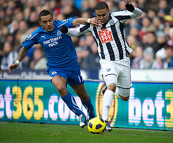 WEST BROMWICH, ENGLAND - Sunday, December 5, 2010: Newcastle United's Danny Simpson and West Bromwich Albion's Jerome Thomas during the Premiership match at the Hawthorns. (Pic by: David Rawcliffe/Propaganda)