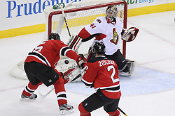 Apr 7; Newark, NJ, USA; New Jersey Devils right wing Petr Sykora (15) scores a goal on Ottawa Senators goalie Craig Anderson (41) during the second period at the Prudential Center.