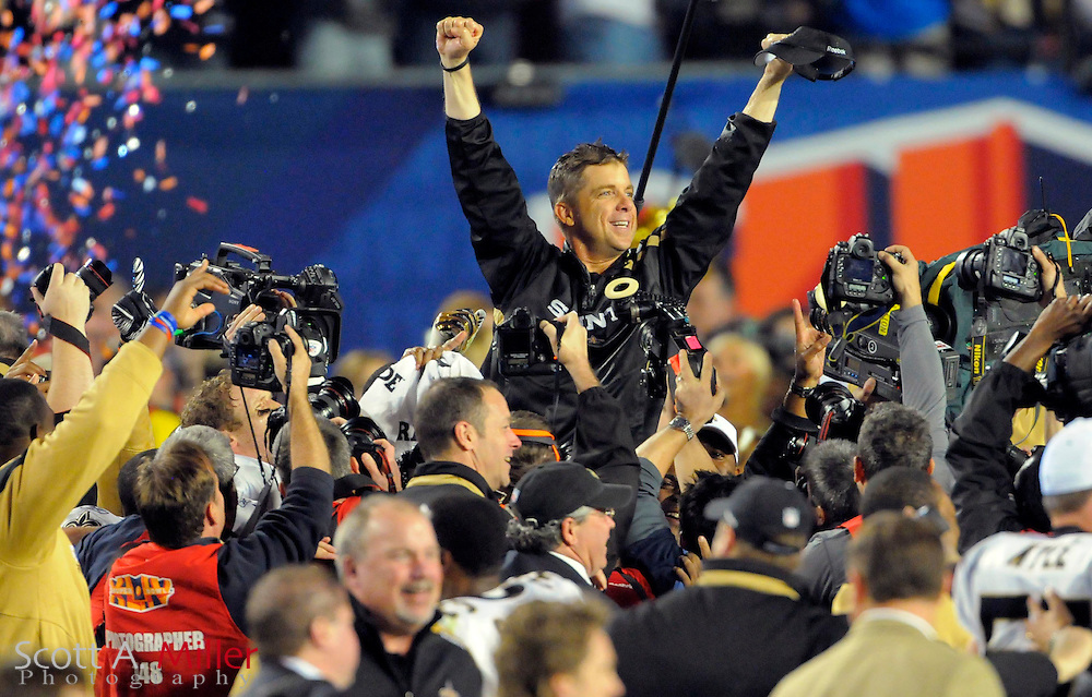 Feb 7, 2010; Miami, FL, USA; New Orleans Saints head coach Sean Payton celebrates after being dunked with a bucket of Gatorade during the fourth quarter of Super Bowl XLIV against the Indianapolis Colts at Sun Life Stadium. The Saints won 31-17. ©2010 Scott A. Miller