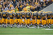 September 25 2010: The Iowa Hawkeyes take the field before the start of the NCAA football game between the Ball State Cardinals and the Iowa Hawkeyes at Kinnick Stadium in Iowa City, Iowa on Saturday September 25, 2010. Iowa defeated Ball State 45-0.