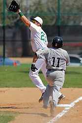 17 April 2016:  Tim Smyk stretches high to nab a put out throw on hitter David Rico during an NCAA division 3 College Conference of Illinois and Wisconsin (CCIW) Pay in Baseball game during the Conference Championship series between the North Central Cardinals and the Illinois Wesleyan Titans at Jack Horenberger Stadium, Bloomington IL