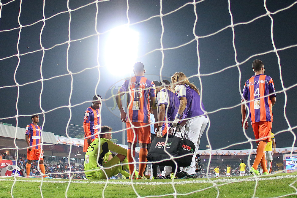 FC Pune City goalkeeper Emanuele Belardi receives treatment during match 17 of the Hero Indian Super League between FC Pune City<br /> and Kerala Blasters FC held at the Shree Shiv Chhatrapati Sports Complex Stadium, Pune, India on the 30th October 2014.<br /> <br /> Photo by:  Ron Gaunt/ ISL/ SPORTZPICS