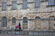 A woman pushed her baby pushchair along a ramp outside Malmaison Boutique Hotel in Oxford Castle Quarter, England, United Kingdom.  The boutique hotel is in a converted prison in a medieval castle in one of the oldest, busiest and trendiest parts of the city.  (photo by Andrew Aitchison / In pictures via Getty Images)