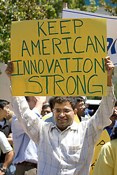 Palo Alto, CALIF. June 24, 2004--Tech Worker Sanjay Noronha protests in opposition to stock option regulations outside Palo Alto City Hall, June 24, 2004 Photo by Kim Kulish
