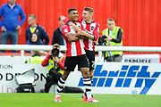 Ollie Watkins (14) of Exeter City celebrates scoring a goal with Jack Stacey (28) of Exeter City to give a 1-0 lead to the home team during the EFL Sky Bet League 2 play off second leg match between Exeter City and Carlisle United at St James' Park, Exeter, England on 18 May 2017. Photo by Graham Hunt.