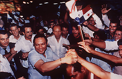 May 30, 2017 - FILE PHOTO - Former Nicaraguan Dictator MANUEL NORIEGA has died at the age of 83. Manuel Antonio Noriega Moreno (February 11, 1934 to May 29, 2017) was a Panamanian politician and military officer. He was military dictator of Panama from 1983 to 1989, when he was removed from power by the United States during the invasion of Panama. Noriega was also a major arms and cocaine trafficker who worked with the CIA. PICTURED: 1988 - Panama City, Panama - Panamanian dictator Manuel Noriega reaches out to flag-waving supporters as body guards watch at a rally outside of Panama City. (Credit Image: © David Walters/TNS via ZUMA Wire)
