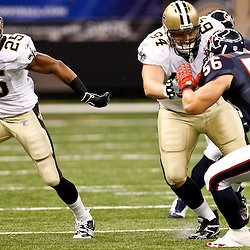 August 21, 2010; New Orleans, LA, USA; New Orleans Saints running back Reggie Bush (25) runs past the block by New Orleans Saints offensive tackle Zach Strief (64) on Houston Texans linebacker Brian Cushing (56) during the first quarter of a preseason game at the Louisiana Superdome. Mandatory Credit: Derick E. Hingle