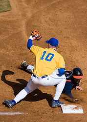 Virginia Cavaliers infielder Tyler Cannon (10) beats a Delaware pickoff attempt.  The Virginia Cavaliers Baseball Team defeated the Delaware Blue Hens 3-2 to complete the sweep of a three game series at Davenport Field in Charlottesville, VA on March 4, 2007.