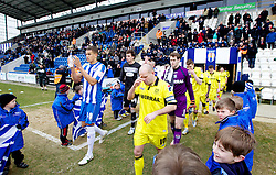 COLCHESTER, ENGLAND - Saturday, February 23, 2013: Tranmere Rovers' captain Andy Robinson makes a final prayer as he enters the pitch alongside Colchester United's captain Josh Thompson before the Football League One match at the Colchester Community Stadium. (Pic by Vegard Grott/Propaganda)