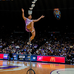 Jan 13, 2018; Baton Rouge, LA, USA; Rong Niu know as Red Panda performs acrobatic unicycle act during the halftime of a game between the LSU Tigers and the Alabama Crimson Tide at the Pete Maravich Assembly Center. Mandatory Credit: Derick E. Hingle-USA TODAY Sports