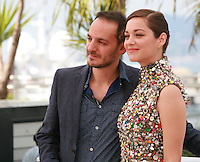 Fabrizio Rongione and Marion Cotillard at the photo call for the film Two Days, One Night (Deux Jours, Une Nuit) at the 67th Cannes Film Festival, Tuesday 20th May 2014, Cannes, France.