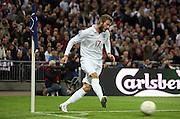 David Beckham of England takes a corner