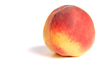 Close-up of peach on white background
