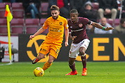 Steven Lawless (#15) of Livingston FC holds off Arnaud Djoum (#10) of Heart of Midlothian during the 4th round of the William Hill Scottish Cup match between Heart of Midlothian and Livingston at Tynecastle Stadium, Edinburgh, Scotland on 20 January 2019.