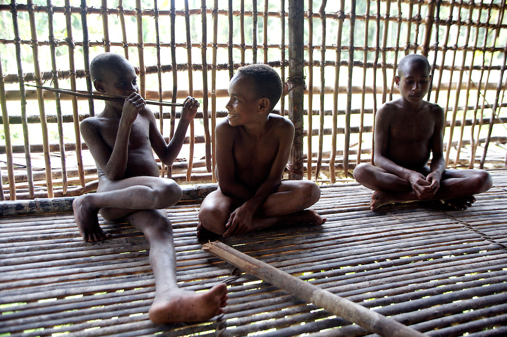 Three young Kombai adolescents, one has a toy bow. West Papua is home to over 300 tribes. They have inhabited the island for more than 40,000 years. Many of the last remaining tribal cultures on our planet can be found in West Papua. An astounding 15% of the world's languages are spoken there, by just 0.01% of the global population.