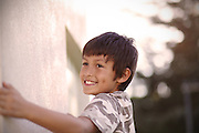 Young boy climbing next to a wall in a park - EXCLUSIVELY AVAILABLE HERE
