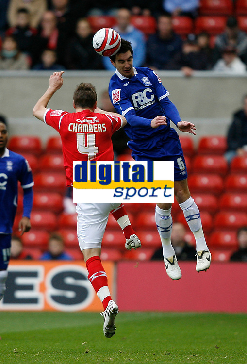 Photo: Richard Lane/Richard Lane Photography. Nottingham Forest v Birmingham City. Coca Cola Championship. 08/11/2008. Luke Chambers (L) is beaten in the air by Liam Ridgewell (R)