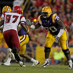 19 September 2009: LSU Tigers tackle Ciron Black (70) blocks against Louisiana-Lafayette Cajuns defensive end Terrell Richardson (97) during a 31-3 win by the LSU Tigers over the University of Louisiana-Lafayette Ragin Cajuns at Tiger Stadium in Baton Rouge, Louisiana.