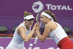 DOHA, Feb. 19, 2018  Gabriela Dabrowski (L) of Canada and Jelena Ostapenko of Latvia celebrate during the double's final match against Andreja Klepac of Slovenia and Maria Jose Martinez Sanchez of Spain at the 2018 WTA Qatar Open in Doha, Qatar, on Feb. 18, 2018. Gabriela Dabrowski and Jelena Ostapenko won 2-0 to claim the title. (Credit Image: © Nikku/Xinhua via ZUMA Wire)