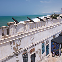 Souvenir stalls in a courtyard of the Cape Coast Castle, a UNESCO World Heritage Site located along the Gold Coast of Ghana.