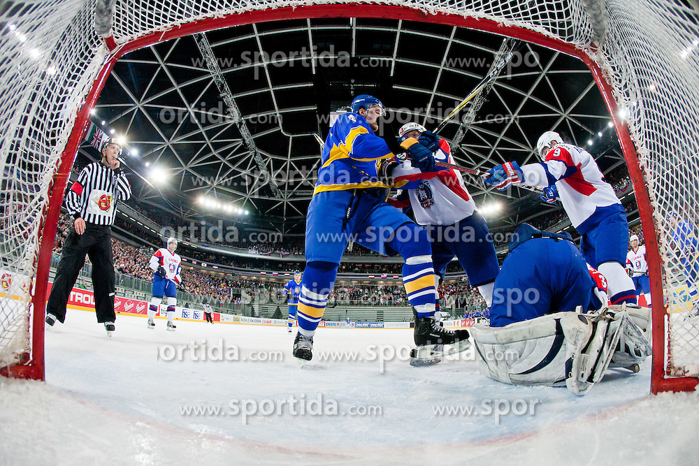 Roughing between Andri Mikhnov of Ukraine and Andrej Tavzelj of Slovenia in front of Robert Kristan of Slovenia net during ice-hockey match between Slovenia and Ukraine at IIHF World Championship DIV. I Group A Slovenia 2012, on April 19, 2012 at SRC Stozice, Ljubljana, Slovenia. (Photo By Matic Klansek Velej / Sportida.com)